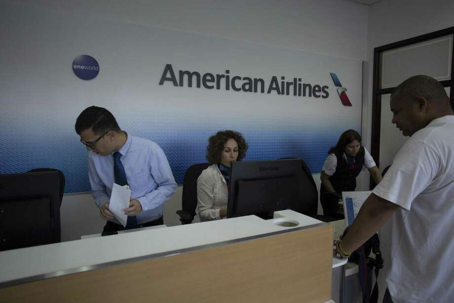 A man buys his ticket at the new American Airlines' office in Havana. Photo: Desmond Boylan /Associated Press / Copyright 2017 The Associated Press. All rights reserved.