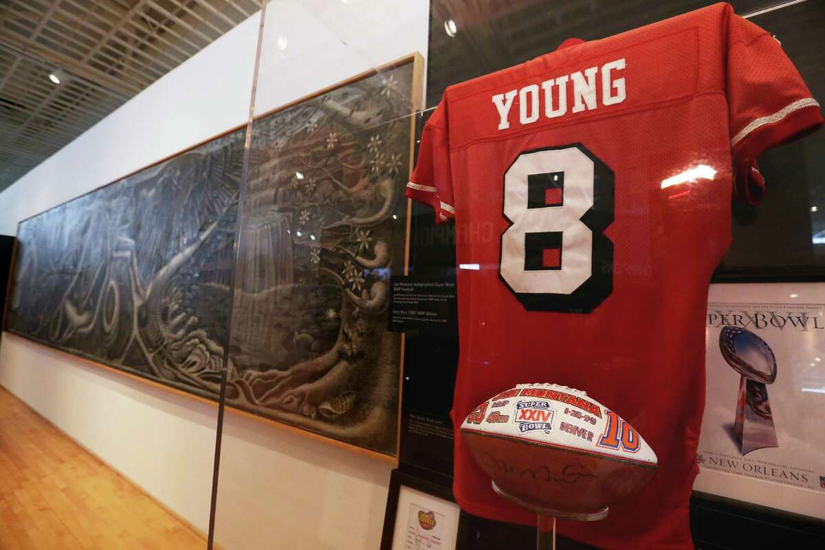 """John T. Biggers' """"Web of Life"""" mural is in display next to the Dynasties section of the Gridiron Glory: The Best of the Pro Football Hall of Fame exhibition at Texas Southern University's University Museum Thursday, Feb. 2, 2017, in Houston."""