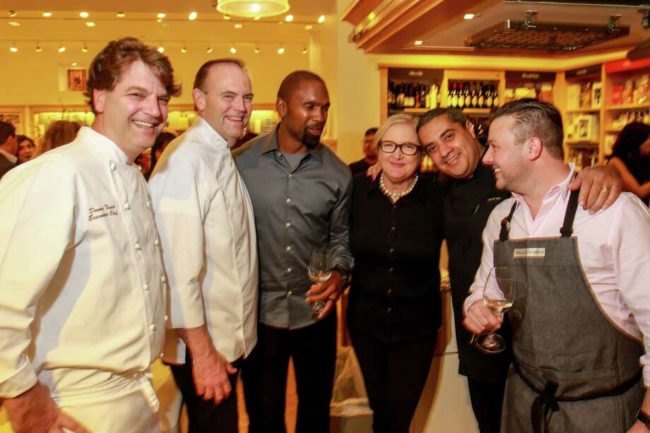 "Chef Danny Trace, from left, chef Charlie Palmer, Charles Woodson, Jean Armstrong of Williams Sonoma, chef Michael Mina, and chef Adam Stobel at the Super Bowl ""cook-off"" at Williams Sonoma. Williams Sonoma is a partner of Culinary Kickoff, and hosted the inaugural Super Bowl ""cook-off"" between two celebrity chef teams. Proceeds benefit the Culinary Institute of America. Photo: Gary Fountain, Gary Fountain/For The Chronicle / Copyright 2017 Gary Fountain"