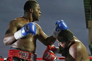Tyrell Herndon (left) punches Jerome Aiken during a pro bout that ended in a draw at Wolf Stadium on Nov. 14, 3015.