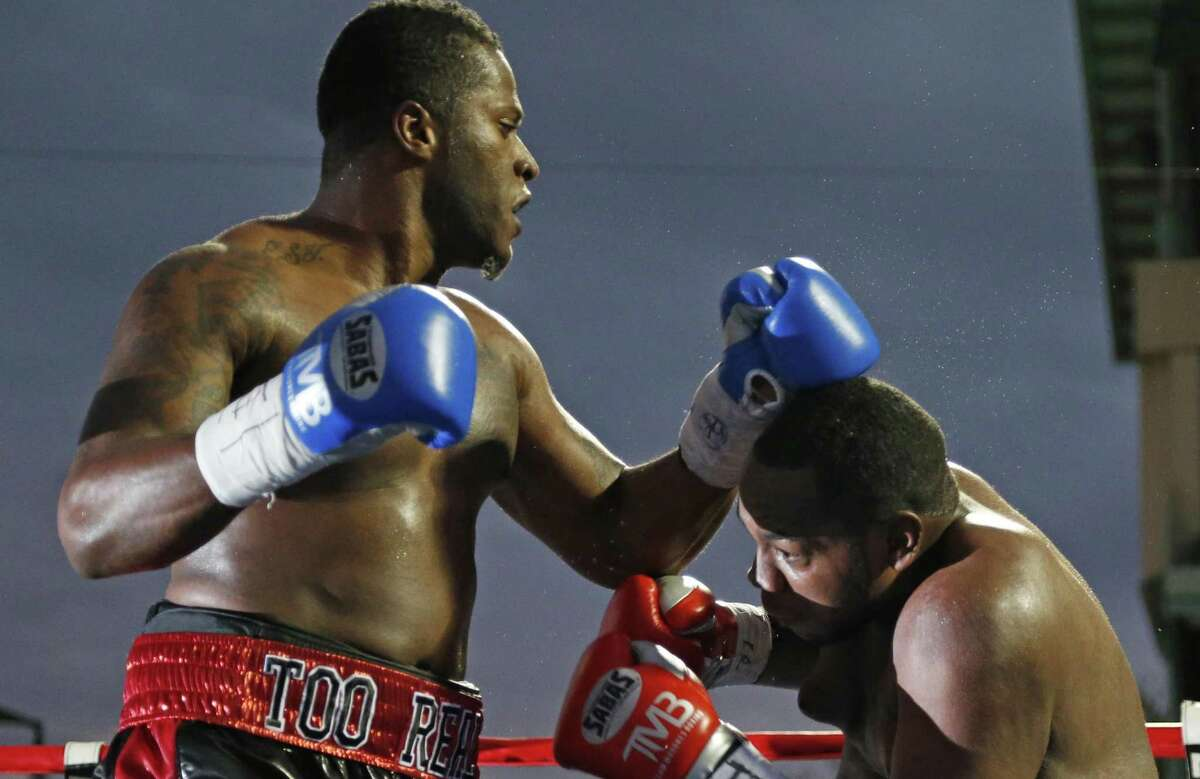 San Antonio's Tyrell Herndon (left) punches Jerome Aiken during a pro boxing match at Wolf Stadium on Nov. 14, 2015.
