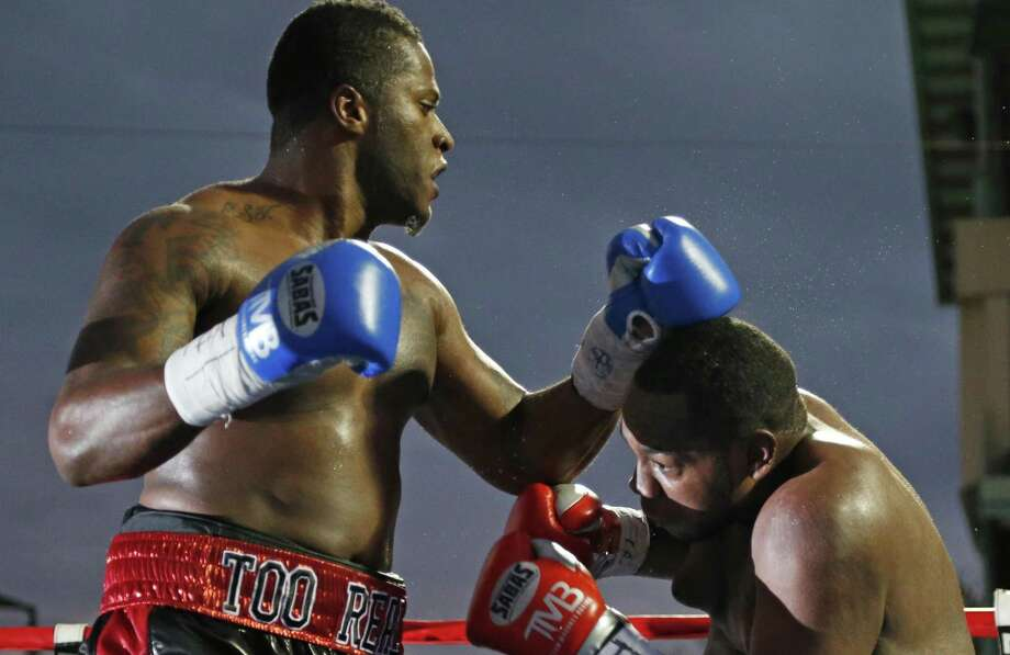 San Antonio's Tyrell Herndon (left) punches Jerome Aiken during a pro boxing match at Wolf Stadium on Nov. 14, 2015. Photo: Ron Cortes /For The Express-News