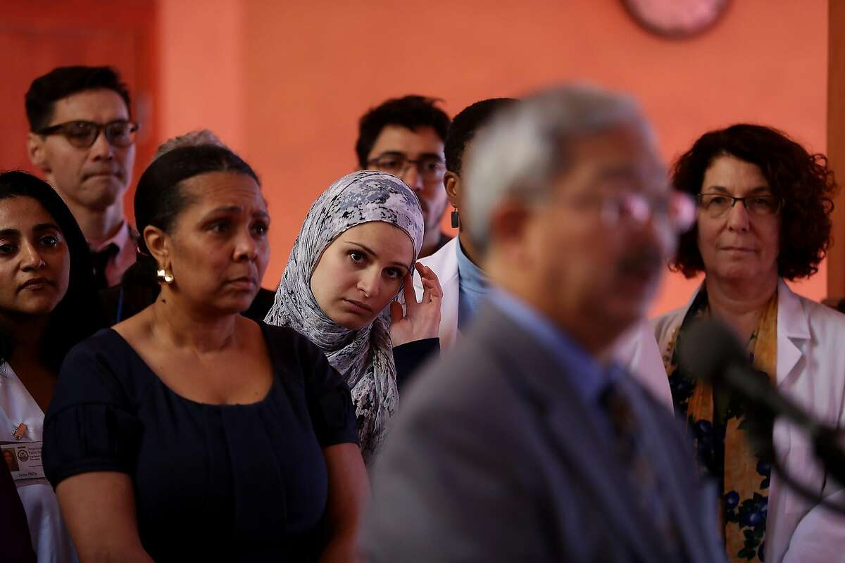 SAN FRANCISCO, CA - JANUARY 13: Attendees look on as San Francisco Mayor Ed Lee speaks during a news conference at the Islamic Society of San Francisco on January 13, 2017 in San Francisco, California. Lee announced the launch of the Equity and Immigrant Services campaign that will provide support for immigration related legal services. (Photo by Justin Sullivan/Getty Images)