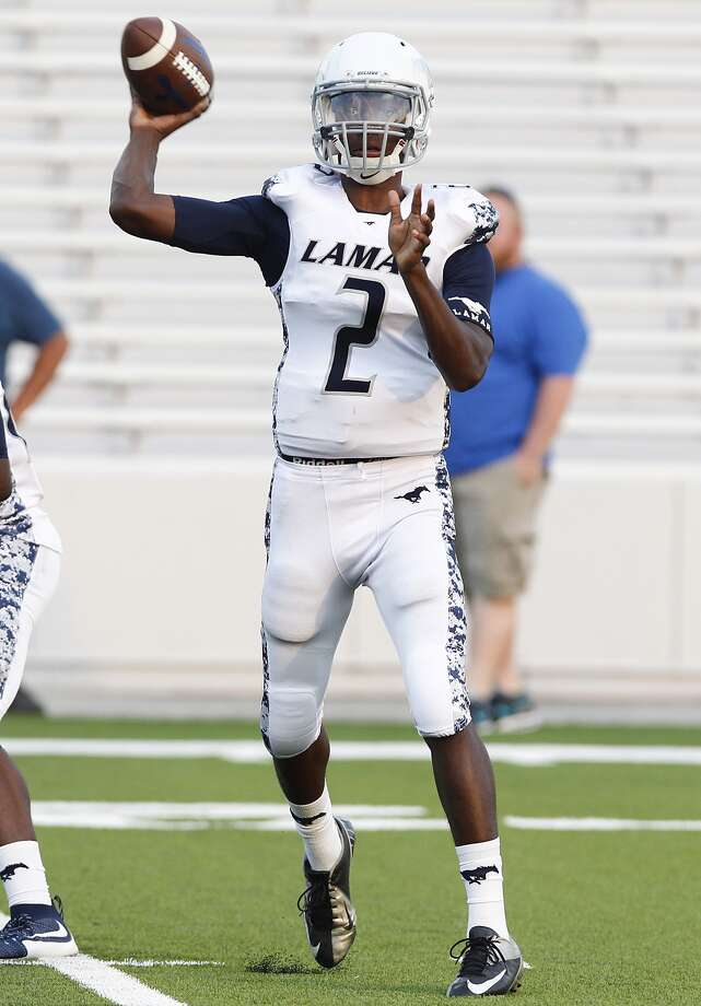 Lamar Consolidated QB Will Brown looks for an open receiver as the Mustangs took on Westside as the two teams faced off in the first game of the season at Delmar Stadium on August 27, 2015. Photo: Diana L. Porter, For The Chronicle / © Diana L. Porter
