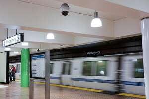 A surveillance camera is seen at the Montgomery BART station while a train passes by in San Francisco, California, on Thursday, Feb. 2, 2017.