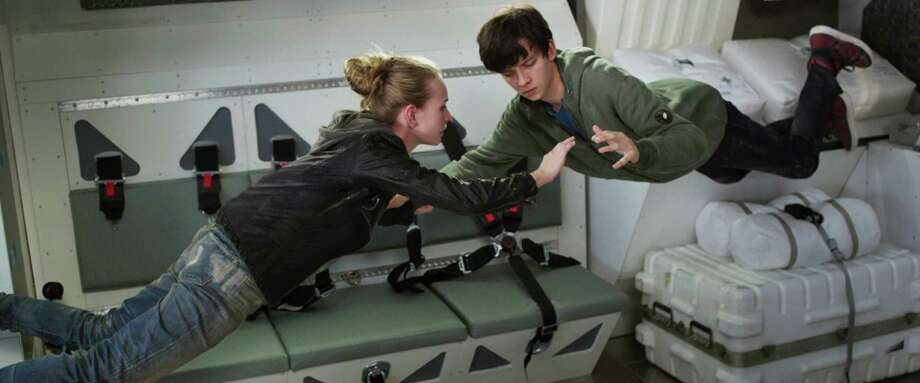 """This image released by STX Productions shows Britt Robertson, left, and Asa Butterfield in a scene from """"The Space Between Us."""" (STX Productions via AP) ORG XMIT: NYET657 / STX Productions"""