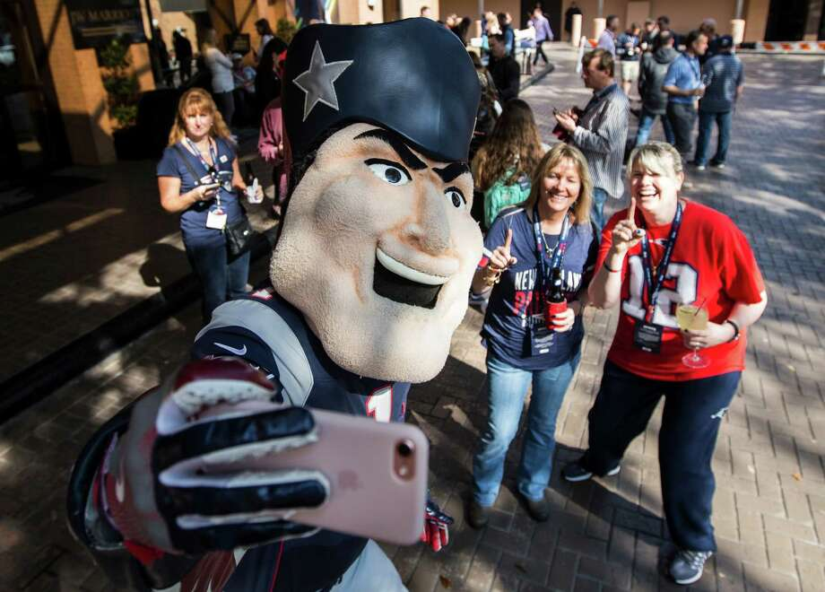 New England Patriots mascot Pat the Patriot takes a selfie as he mingles with fans outside the team hotel on Thursday, Feb. 2, 2017, in Houston. Photo: Brett Coomer, Houston Chronicle / © 2017 Houston Chronicle