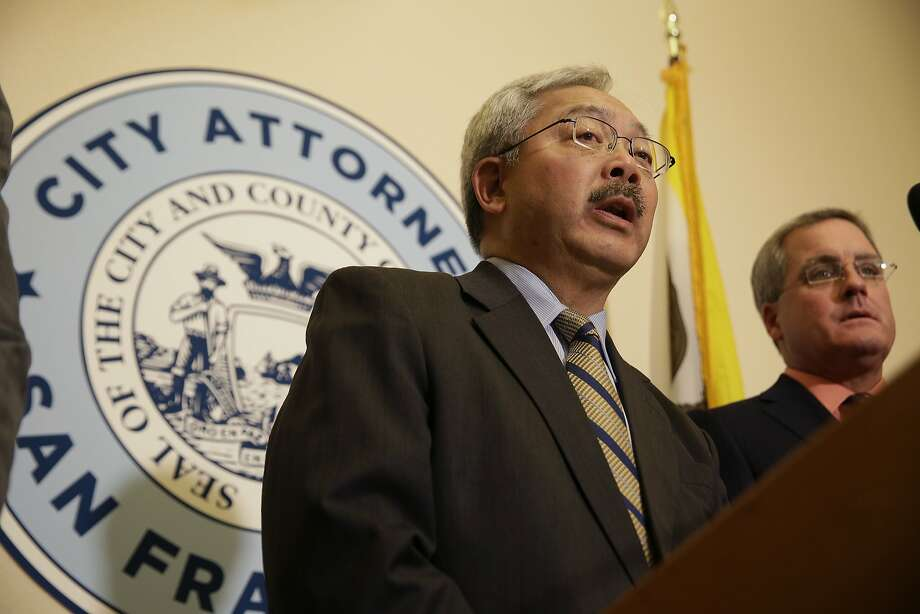 FILE - San Francisco Mayor Ed Lee, left, and City Attorney Dennis Herrera, right, answer questions about a lawsuit against President Donald Trump during a news conference at City Hall Tuesday, Jan. 31, 2017, in San Francisco. The mayor approved recreational pot rules for the city Wednesday. Photo: Eric Risberg, Associated Press