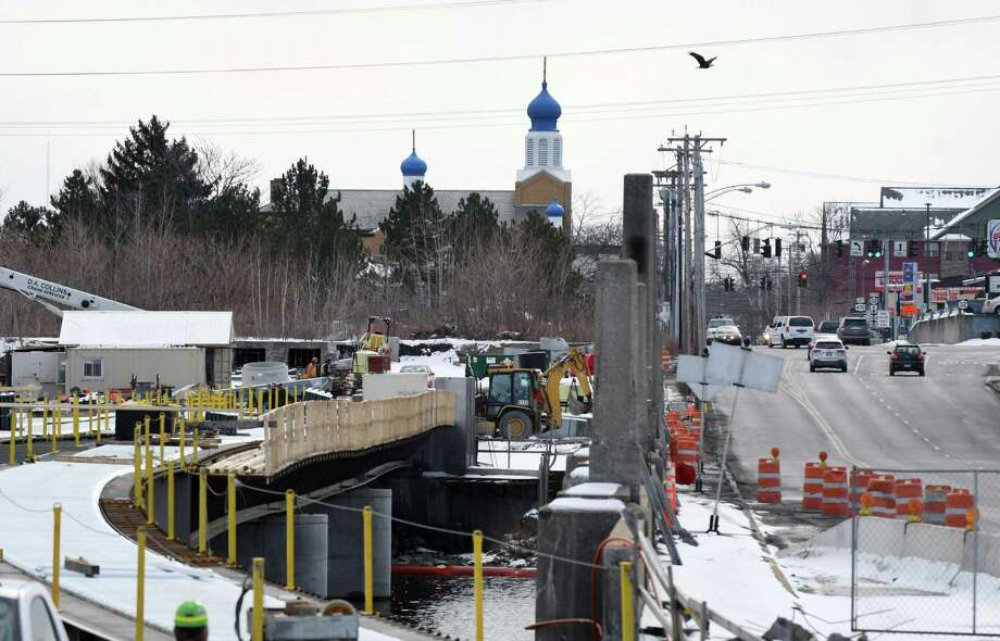 Work continues on a new bridge between Cohoes and Waterford on Route 32 as a bald eagle flies overhead on Thursday afternoon, Jan. 2, 2017, in Waterford, N.Y. (Will Waldron/Times Union) Photo: Will Waldron