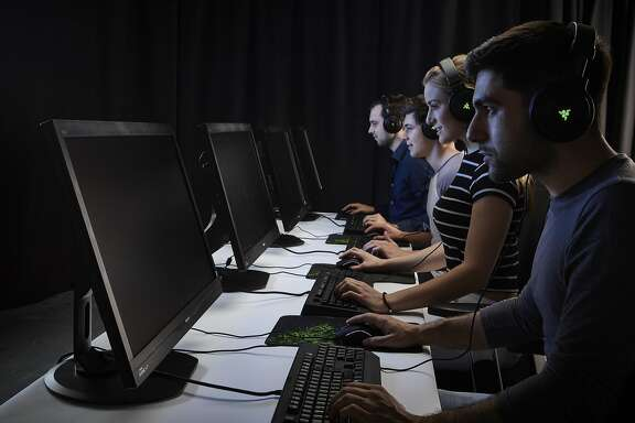 A group of male and female gamers playing PC games while wearing headsets, taken on November 6, 2015. (Photo by Olly Curtis/Future Publishing via Getty Images)