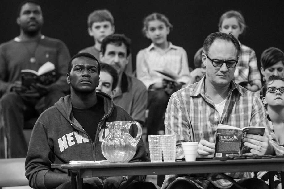 "Seated at table, left to right are Andrew Carson (Tom Robinson) and  Jason Douglas (Atticus Finch) in A.D. Players' ""To Kill a Mockingbird."" The play opens up the new Jeannette and L.M. George Theater (George Theater)."