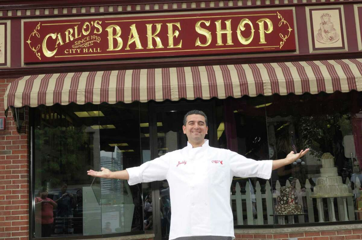 Baker Buddy Valastro stands outside of his Hoboken, New Jersey, bakery, which is selling slices across the country now.
