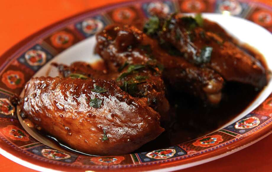 Fish and soy sauce glazed chicken wings with fried curry leaf at BackBar at 347 Warren St. on Thursday, Jan. 26, 2017 in Hudson, N.Y. (Lori Van Buren / Times Union) Photo: Lori Van Buren / 20039517A