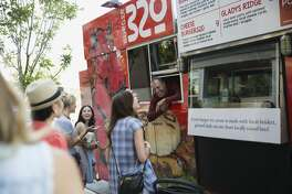 Customers ordering at food truck