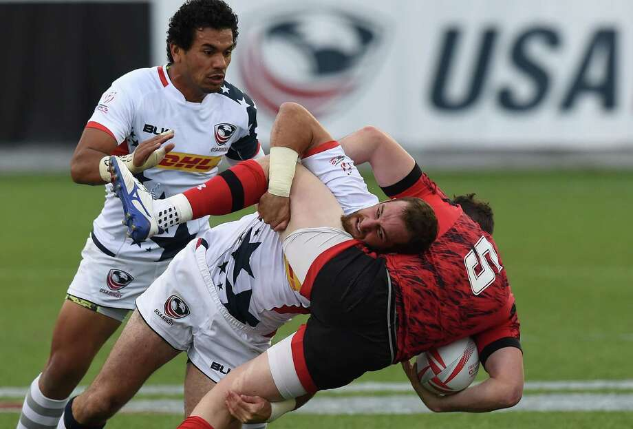Zack Test of the United States (center) tackles Owen Jenkins of Wales during a 2016 USA Sevens Rugby Tournament match at the Sam Boyd Stadium in Las Vegas. Photo: Mark Ralston /Getty Images / AFP or licensors