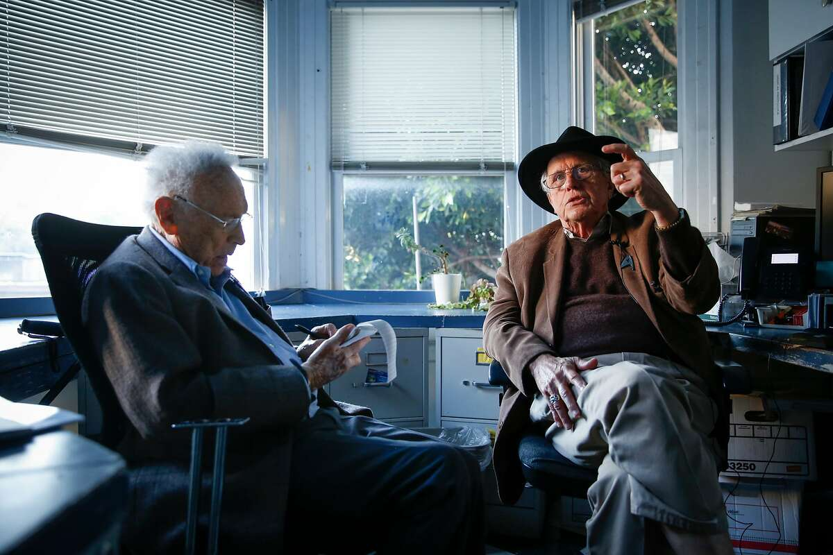 Chronicle reporter David Perlman, left, interviews Dr. David E. Smith, who founded and opened the Haight Ashbury Free Medical Clinic.
