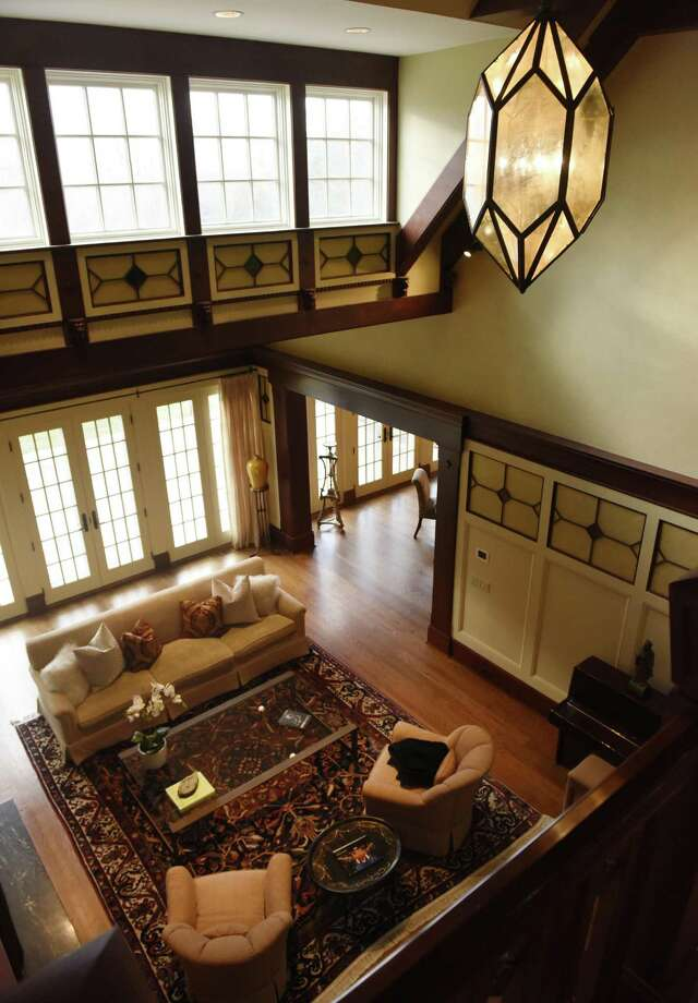 A high ceiling living room lets in natural light in the home at 636 riversville