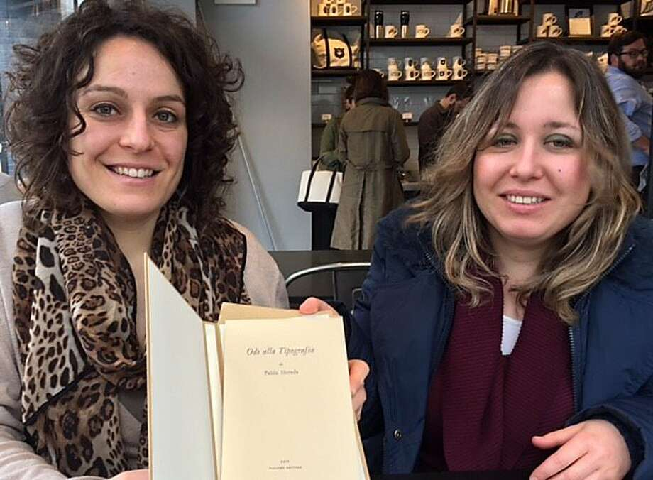 Elisa and Eleonora Tallone with a Pablo Neruda tribute to their grandfather Alberto Tallone. Photo: Leah Garchik, San Francisco Chronicle