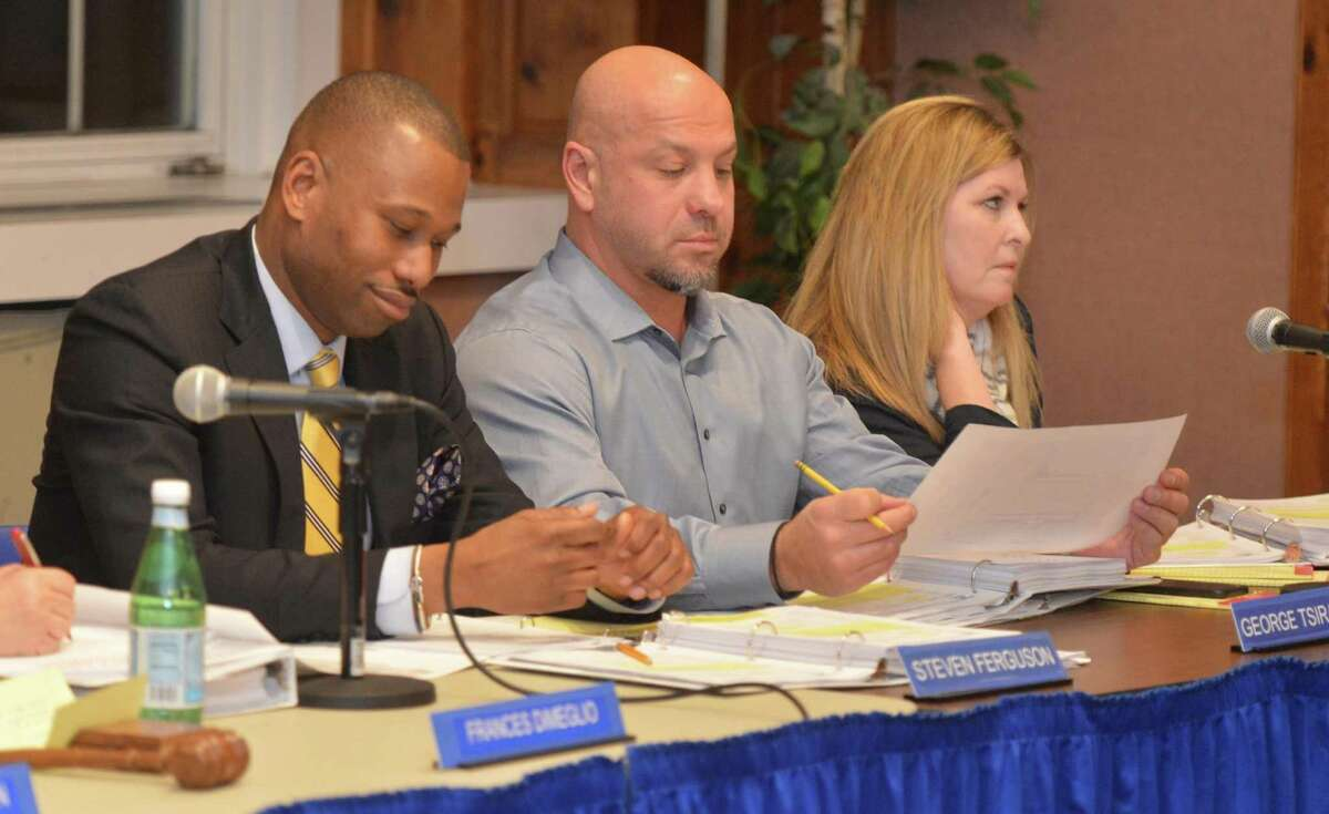 Memebers of the Norwalk Planning Commission listen to public comment on the school capitol budget at Norwalk City Hall on Wednesday february 1, 2017