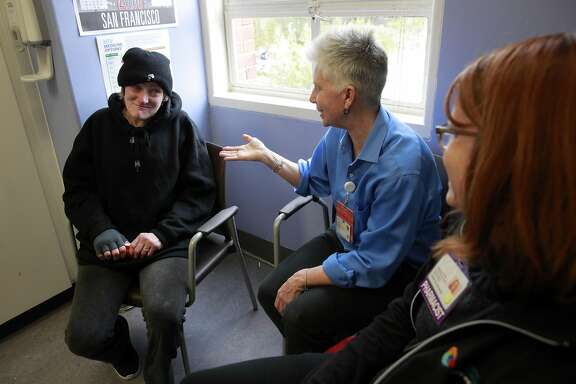HIV patient Pamela Phelan, (left) meets with RN Valerie Robb, (center) and pharmacist Janet Grochowski during an appointment in San Francisco Ca. on Thursday Feb. 2, 2017. San Francisco General Hospital�s long-time HIV ward has made a remarkable new addition: a geriatric clinic called Golden Compass. As Ward 86 patients grow older the clinic will address the needs of an aging AIDS population.