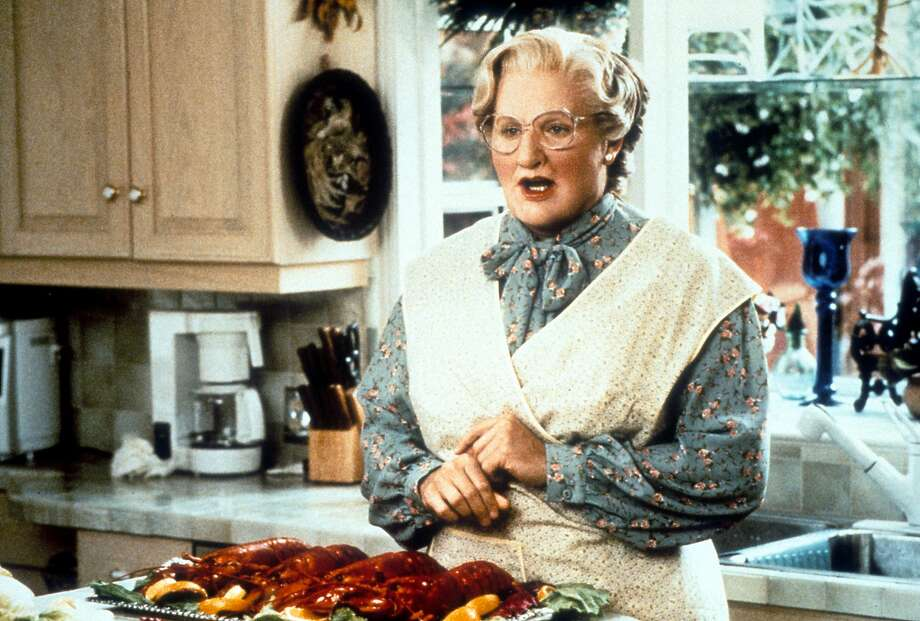 "Robin Williams in the kitchen in a scene from the film ""Mrs. Doubtfire."" How much does the famous home really cost? Keep clicking to find out. Photo: Archive Photos, Getty Images"