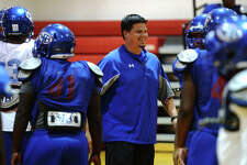 Defensive coordinator Eric Peevey grins after a play during practice Wednesday. The West Brook Bruins practiced in the gym Wednesday afternoon due to inclement weather. Photo taken Wednesday 9/17/14 Jake Daniels/@JakeD_in_SETX