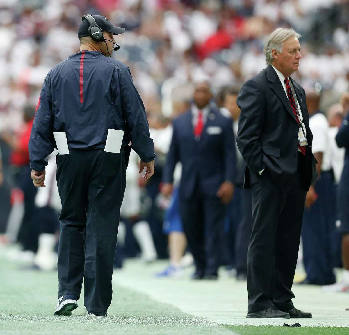 Dr. Arthur Day stands in the Texans bench area near Bill O'Brien during the third quarter of an NFL football game at NRG Stadium on Sunday, Sept. 13, 2015.