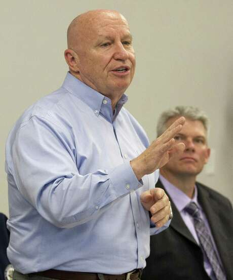 House Ways and Means Committee Chairman Rep. Kevin Brady, R-The Woodlands, addresses business leaders' concerns about repealing and replacing the Affordable Care Act as J.J. Hollie, president of The Woodlands Area Chamber of Commerce, looks on at The Woodlands Area Chamber of Commerce Tuesday, Jan. 17, 2017, in The Woodlands. Photo: Jason Fochtman, Staff Photographer / Houston Chronicle / © 2017 Houston Chronicle