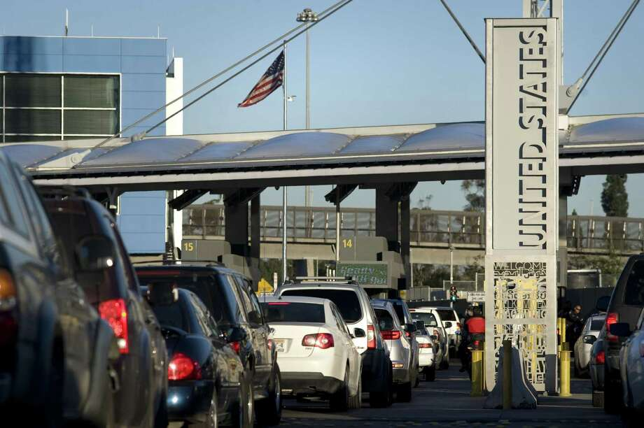 FILE – An American flag flies above early morning traffic at the San Ysidro Port of Entry for the U.S.-Mexico border crossing in Tijuana, Mexico in this file photo from Thursday, Jan. 26, 2017. This entry point to the U.S. was the site of the death of Cruz Velazquez Acevedo, who died after allegedly being order to drink liquid meth by border patrol officers. Photo: David Maung / © 2017 Bloomberg Finance LP