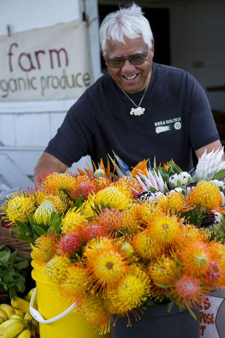 Flowers thrive in Waimea's lush, temperate climate, as shown by blossoms at farmers' markets in the Big Island town. Photo: Dana Edmunds / HTA