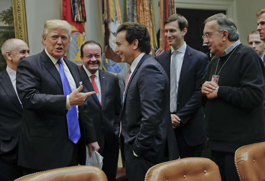 President Donald Trump points to Ford Motors CEO Mark Fields, center, at the start of a meeting with automobile leaders in the Roosevelt Room of the White House in Washington, Tuesday, Jan. 24, 2017. Also at the meeting are Fiat Chrysler Automobiles CEO Sergio Marchionne, right, and White House Senior Adviser Jared Kushner, second from the right. (AP Photo/Pablo Martinez Monsivais) Photo: Pablo Martinez Monsivais, Associated Press