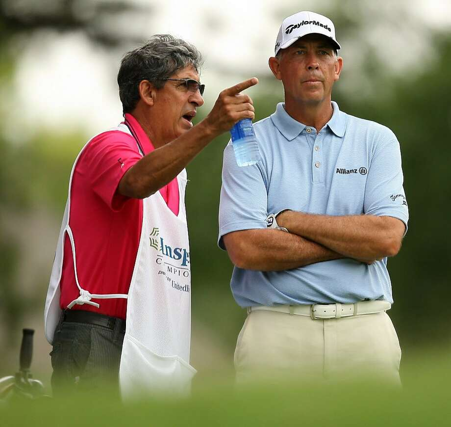 Tom Lehman confers with caddie Andrew Martinez on No. 8 tee in the final round of the Insperity Championship in 2012. Photo: Eric Christian Smith, For The Chronicle