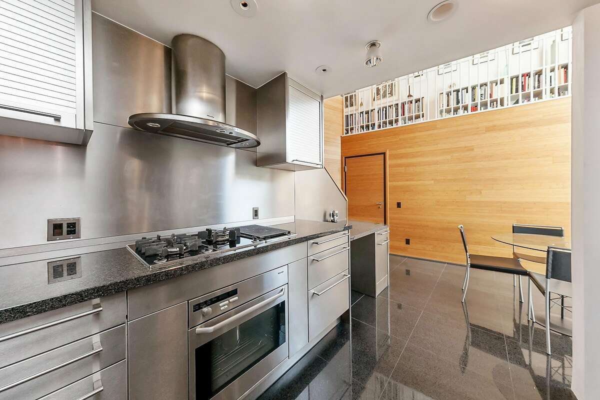 Stainless steel drawers, backsplashes, and cabinets fashion the ultra-contemporary kitchen.