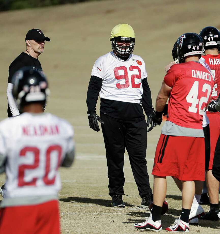 Atlanta Falcons' Joe Vellano (92) works out with teammates under the watch of head coach Dan Quinn, left, at the football team's practice facility in Flowery Branch, Ga., Wednesday, Jan. 25, 2017. (AP Photo/David Goldman) ORG XMIT: GADG115 Photo: David Goldman / Copyright 2017 The Associated Press. All rights reserved.