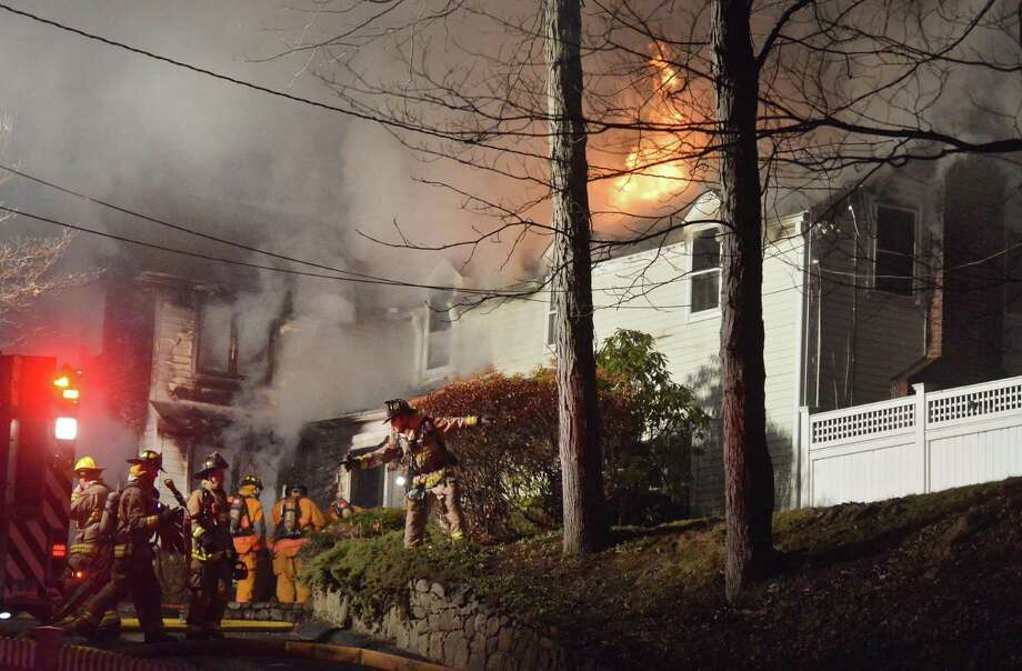 Wilton firefighters respond to a single-family house on fire on Shadow Lane Thursday evening in Wilton. The surrounding towns of Ridgefield, Georgetown, Norwalk, Weston New Canaan and Westport provided mutual aid and extra tanker trucks to battle the blaze. No injuries to the homeowners were reported, the house was a total loss. Photo: Alex Von Kleydorff / Hearst Connecticut Media / Connecticut Post