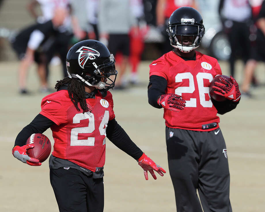 FILE - In this Wednesday, Jan. 18, 2017, file photo,  Atlanta Falcons running backs Devonta Freeman, left, and Tevin Coleman run drills during practice for the NFL football NFC championship game in Flowery Branch, Ga. Freeman and Coleman feel like brothers. They're going to enjoy it while they can, because this is not likely to be a long-term partnership. (Curtis Compton/Atlanta Journal-Constitution via AP, File) ORG XMIT: GAATJ301 Photo: Curtis Compton / Atlanta Journal-Constitution