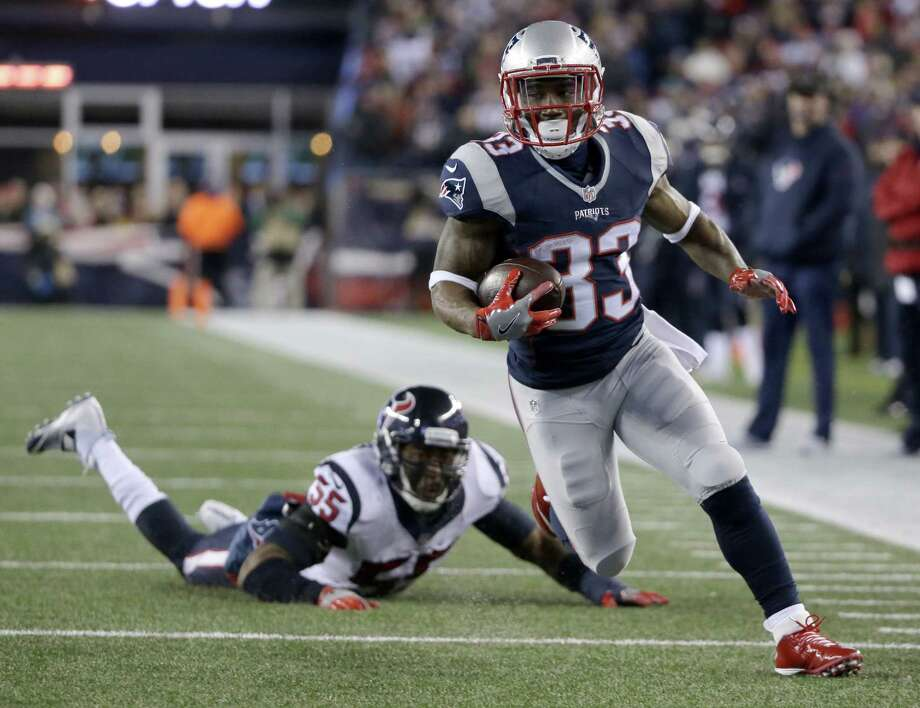 FILE - In this Jan. 14, 2017, file photo, New England Patriots running back Dion Lewis (33) runs past Houston Texans linebacker Benardrick McKinney (55) for a touchdown during the first half of an NFL divisional playoff football game in Foxborough, Mass. In last week's 34-16 win over Houston, Lewis became the first player in the Super Bowl era to score on a run, a catch and a kick return in a postseason game.  (AP Photo/Steven Senne, File) ORG XMIT: NY179 ORG XMIT: MER2017011915163458 Photo: Steven Senne / Copyright 2017 The Associated Press. All rights reserved.