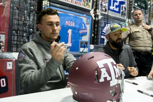 Former Aggie Johnny Manziel prepares to sign an Texas A&M football helmet during a Johnny Manziel autograph event at Stadium Signatures, Thursday, February 2, 2017, in Houston. (Juan DeLeon/Houston Chronicle )