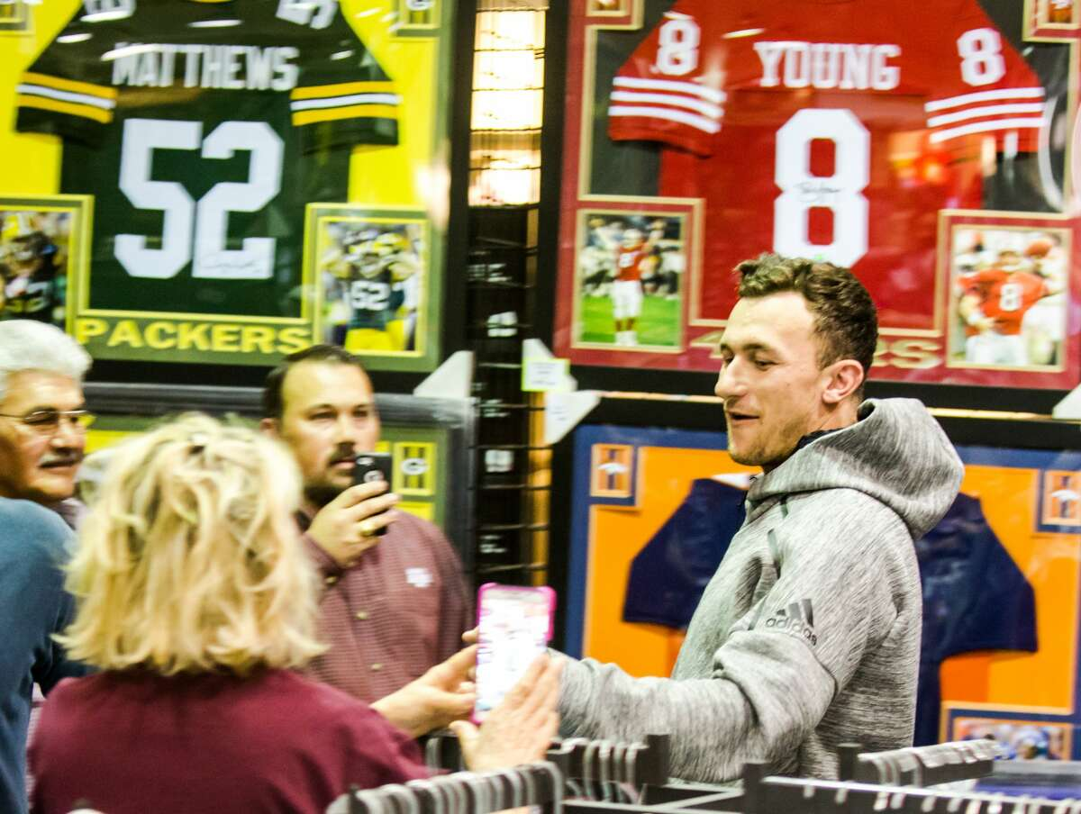 Former Aggie Johnny Manziel greets fans waiting in line for a photo during a Johnny Manziel autograph event at Stadium Signatures, Thursday, February 2, 2017, in Houston. (Juan DeLeon/Houston Chronicle )