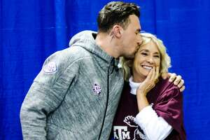 Aggie fan Sherry Collins from Waco celebrates her birthday by receiving a kiss from former Aggie Johnny Manziel during a Johnny Manziel autograph event at Stadium Signatures, Thursday, February 2, 2017, in Houston. (Juan DeLeon/Houston Chronicle )