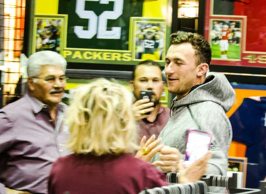 Former Aggie Johnny Manziel greets fans waiting in line for a photo during a Johnny Manziel autograph event at Stadium Signatures, Thursday, February 2, 2017, in Houston. (Juan DeLeon/Houston Chronicle ) Photo: Juan DeLeon/For The Chronicle