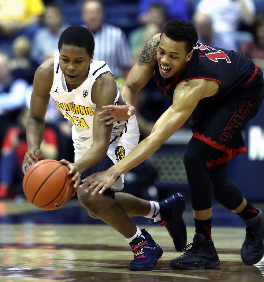 California's Charlie Moore steals the ball from Utah's Lorenzo Bonam in final seconds of 1st half during Pac12 men's basketball game at Haas Pavilion in Berkeley, Calif., on Thursday, February 2, 2017. Photo: Scott Strazzante, The Chronicle