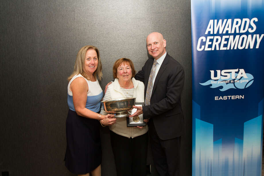 Sue Wold, center, of Troy receives the USTA Eastern's Tennis Woman of the Year Award.