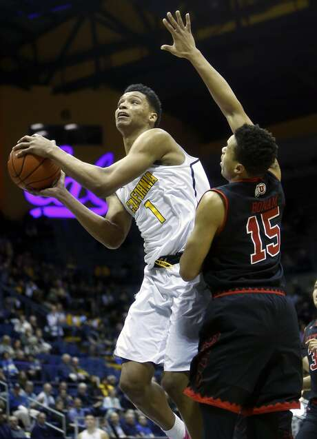 Cal's Ivan Rabb scores against Utah's Lorenzo Bonam in the first half of a Pac-12 game against visiting Utah in February. Photo: Scott Strazzante, The Chronicle