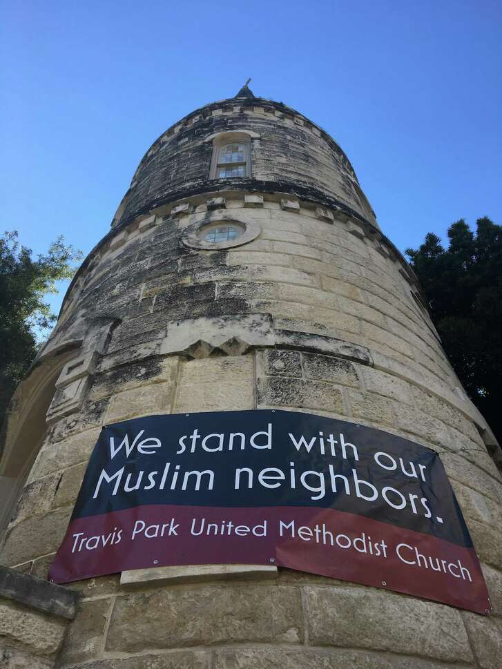The tower of Travis Park United Methodist Church proclaims its support for Muslims in the midst of President Donald Trump executive order banning travel from seven predominantly Muslim countries