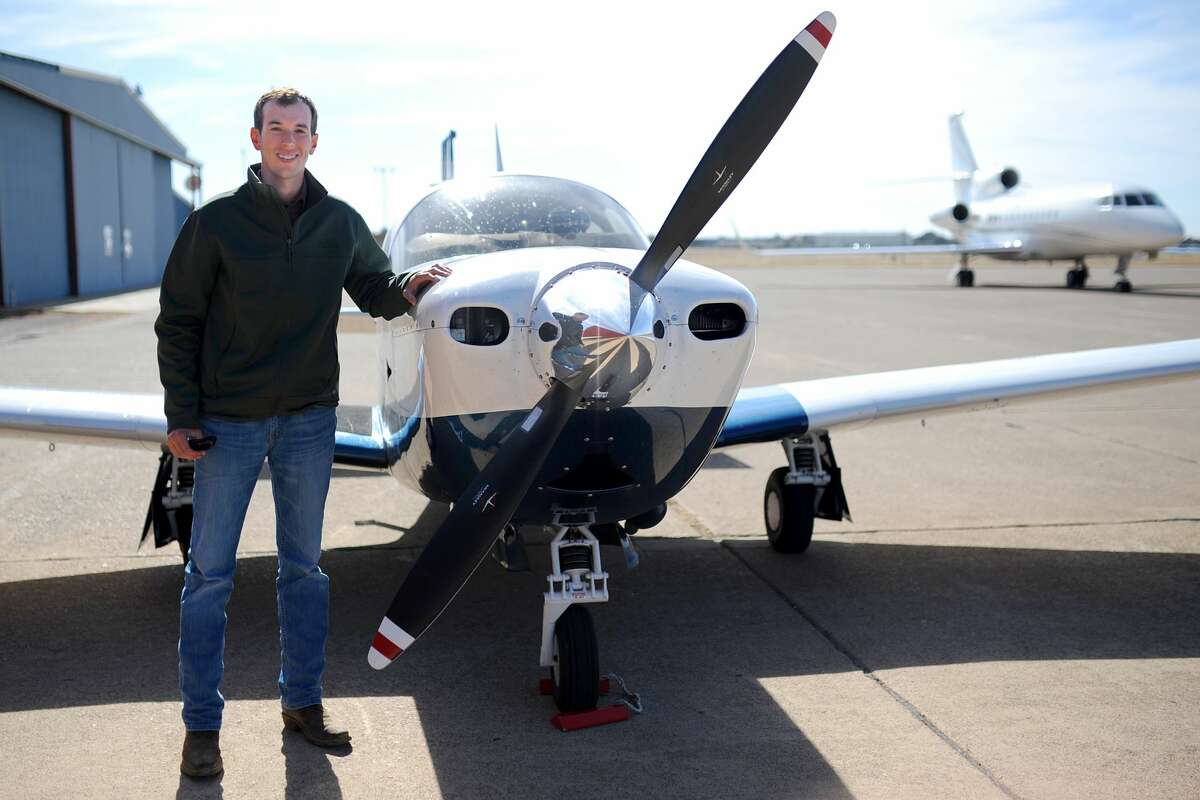 Matt Berkebile poses with the aircraft he uses to fly patients to medical centers, Thursday, Feb. 2, 2017, at Midland Airpark. James Durbin/Reporter-Telegram