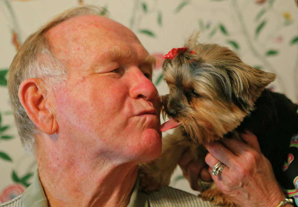 Tommy Nobis gets a kiss from his dog, Rosie, at the family home on June 13, 2013, in Sandy Springs, Georgia. No. 60 officially turns 70 on Friday. No fuss for the First Falcon on a landmark occasion. (Curtis Compton/Atlanta Journal-Constitution/MCT)