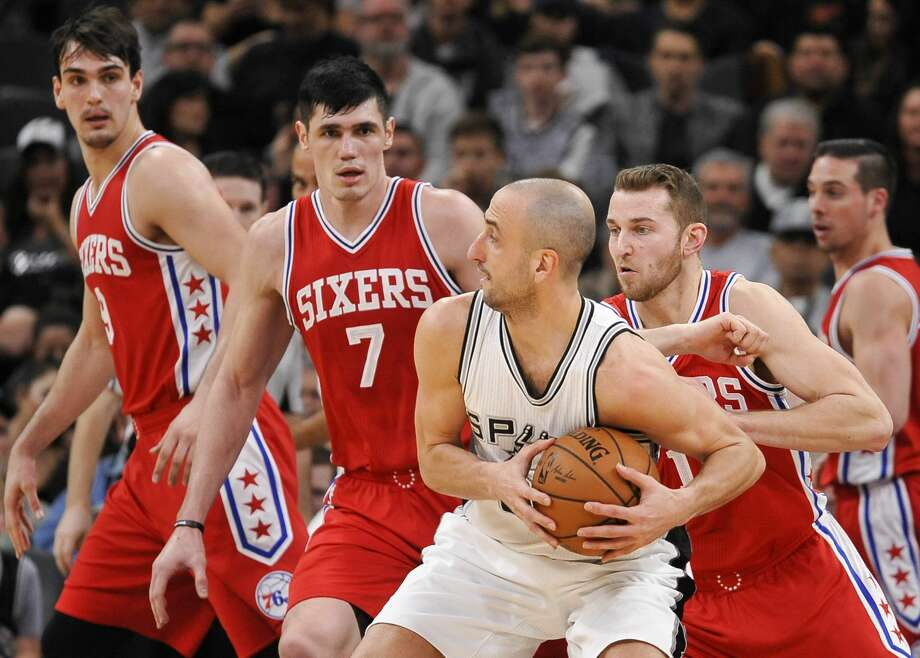San Antonio Spurs guard Manu Ginobili, center right, of Argentina, tangles with Philadelphia 76ers' Ersan Ilyasova (7), of Turkey, and T.J. McConnell (1) during the first half of an NBA basketball game, Thursday, Feb. 2, 2017, in San Antonio. (AP Photo/Darren Abate) Photo: Darren Abate/Associated Press