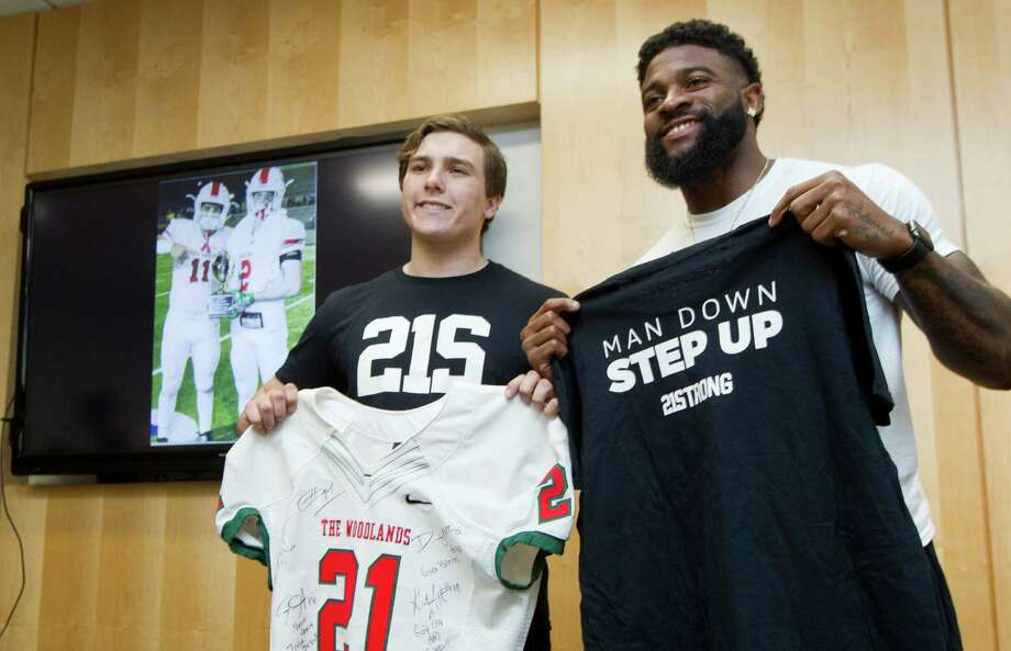 Event organizer Grant Farley, a senior at The Woodlands High School, poses for a photo with Joe Anderson, NFL wide receiver, during a 21 Strong Foundation event to raise funds to support high school athletes with brain injuries at Mercedes-Benz of The Woodlands Thursday, Feb. 2, 2017, in The Woodlands. The Woodlands linebacker Grant Milton suffered a serious head injury during the team's win over Austin Bowie in a UIL Class 6A Division I regional semifinal playoff game on Nov. 26, 2016, at Baylor's McLane Stadium. He was taken to a Waco hospital to have emergency surgery, and transferred to a medical facility in The Woodlands in December. Photo: Jason Fochtman, Staff Photographer / © 2017 Houston Chronicle