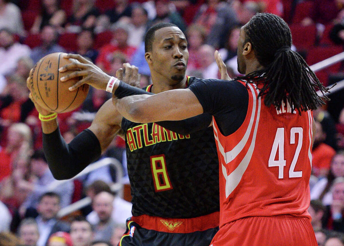 Atlanta Hawks center Dwight Howard (8) pulls the ball away from Houston Rockets center Nene (42) during the second half of an NBA basketball game Thursday, Feb. 2, 2017, in Houston. (AP Photo/George Bridges)